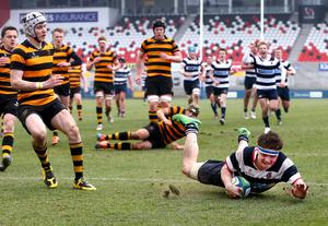 Wallace High Schools Max Trouton scoring a try against RABI during the Danske Bank Ulster Schools' Cup final at the Kingspan Stadium.