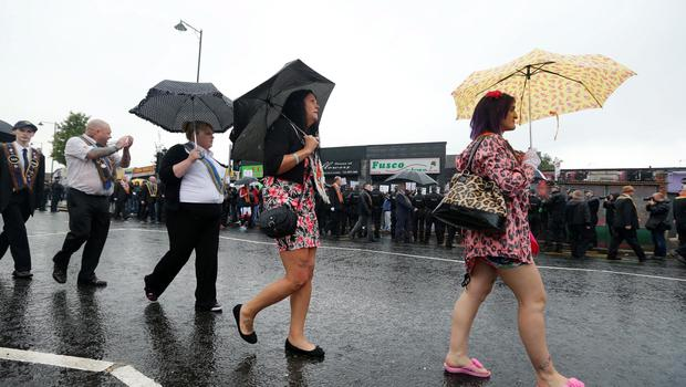 Press Eye Photography - Northern Ireland - 13th July 2015  Orange parade at Ardoyne, North Belfast   Members of the Orange Order and marchers parade along the Crumlin Road at Ardoyne shops in North Belfast as protestors and members of Greater Ardoyne Residents Collective (GARC)  protest against the parade.  Picture by Kelvin Boyes / Press Eye