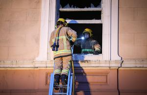 Picture - Kevin Scott / Presseye  Monday 15th June 2015 - Crumlin Road Court Fire Pictured is firefighters at the scene of a malicious fire at the Crumlin Road Court house in Belfast at around 9:30pm on Monday Night. The incident was one of 3 malicious fires dealt with firefighters in the North Belfast Area. At around 9pm a builders merchants on the Oldpark road was set alight for the 3rd time in 5 days and in the Franklin St area a skip was set alight close to business premises.    Picture - Kevin Scott / Presseye