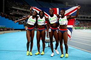 RIO DE JANEIRO, BRAZIL - AUGUST 19:  Asha Philip, Desiree Henry, Dina Asher-Smith and Daryll Neita of Great Britain celebrate winning bronze in the Women's 4 x 100m Relay Final on Day 14 of the Rio 2016 Olympic Games at the Olympic Stadium on August 19, 2016 in Rio de Janeiro, Brazil.  (Photo by Cameron Spencer/Getty Images)