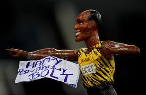 RIO DE JANEIRO, BRAZIL - AUGUST 19:  Usain Bolt of Jamaica celebrates with a fan's likeness of him after winning the Men's 4 x 100m Relay Final on Day 14 of the Rio 2016 Olympic Games at the Olympic Stadium on August 19, 2016 in Rio de Janeiro, Brazil.  (Photo by Laurence Griffiths/Getty Images)