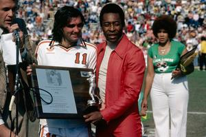George Best and Pele finally came face to face during their days playing in the North American Soccer League. Here, Best presents the Brazilian with a plaque, recognising Pele as the best player in the world during Pele Appreciation Day at Rose Bowl stadium in Pasedena, California, in 1978.