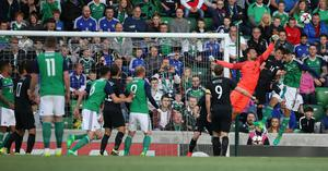 PressEye-Northern Ireland- 2nd June 2017-Picture by Brian Little/PressEye  New Zealand  goal keeper Stefan Marinovic defends a a Northern Ireland cross  during Friday night's Vauxhall  International at  the National Football Stadium, Windsor Park ,Belfast. Picture by Brian Little/PressEye