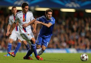 Chelsea's Juan Mata (right) and FC Basel's Fabian Schar in action during the UEFA Champions League, Group E match at Stamford Bridge, London. PRESS ASSOCIATION Photo. Picture date: Wednesday September 18, 2013. See PA story SOCCER Chelsea. Photo credit should read: Nick Potts/PA Wire
