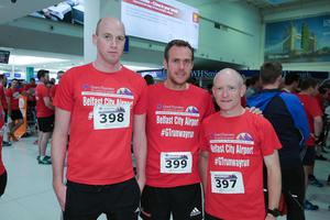 GRANT THORNTON RUNWAY RUN SCALES NEW HEIGHTS Mark Jameson, Paul Tyro and Ed Kelly from Pinsent Masons get warmed up for last night's Grant Thornton Runway Run at Belfast City Airport. The hugely-popular event attracted a record number of runners as 600 local businessmen and women took part in the 5k run on the tarmac of the airport. Teams of four from organisations across a wide range of sectors came together for the third year of the leading business advisory firm's event.