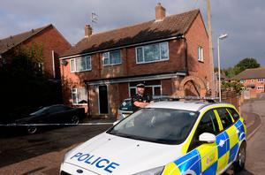 Police outside a house on the junction of Harwich Road with Tara Close in Colchester, Essex. Pic: Stefan Rousseau/PA Wire