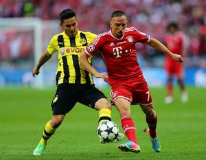 LONDON, ENGLAND - MAY 25:  Franck Ribery of Bayern Muenchen (R) in action with Ilkay Gundogan of Borussia Dortmund during the UEFA Champions League final match between Borussia Dortmund and FC Bayern Muenchen at Wembley Stadium on May 25, 2013 in London, United Kingdom.  (Photo by Alex Grimm/Getty Images)