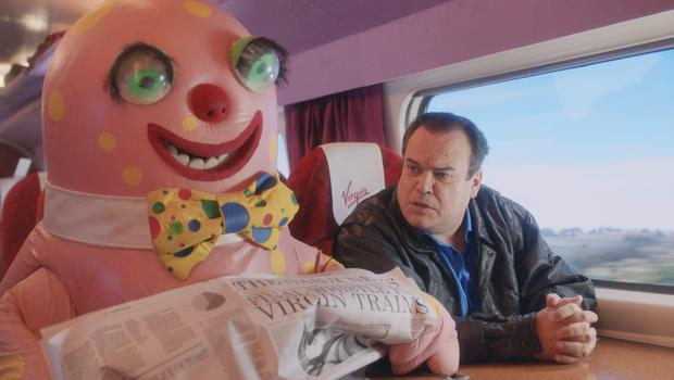Mr Blobby and Shaun Williamson, who played Barry in Eastenders (Virgin Trains/PA)