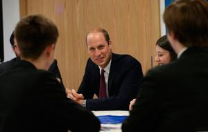 The Duke of Cambridge talks to students from Our Lady & St PatrickÕs College, Knock during a visit  to Inspire, a charity and social enterprise which focuses on promoting wellbeing for all across the island of Ireland, as part of his tour of Belfast. PRESS ASSOCIATION Photo. Picture date: Wednesday October 4, 2017.