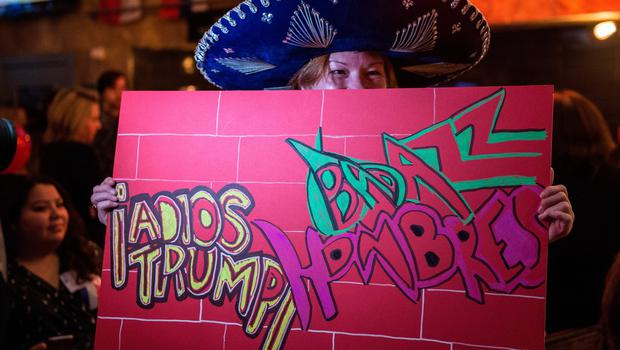LONDON, ENGLAND - NOVEMBER 08:  A Democrat holds up a home made anti-Trump sign at the Democrats Abroad US election night party at Marylebone Sports Bar and Grill on November 8, 2016 in London, England. Americans have gone to the polls today, November 8, to elect the 45th President of the United States. Democratic presidential candidate Hillary Clinton, if elected, would be the first woman president in American history. Clinton is running against Republican presidential candidate Donald Trump. (Photo by Chris J Ratcliffe/Getty Images)