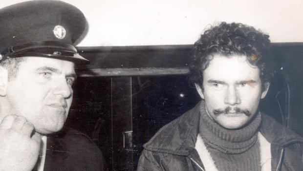 Martin McGuinness handcuffed to a policeman after being remanded at Special Criminal Court in Dublin, January 1973.