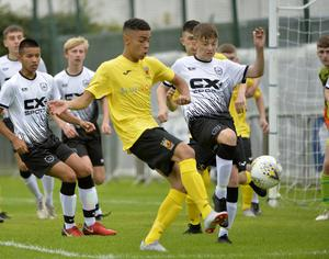 29th July 2019 Statsports Supercup NI 2019 Junior match between County Antrim and Dundalk at Broughshane. Antrims Brodie Spencer  in action with Dundalks Oisin Coleman Mandatory Credit : Stephen Hamilton/Presseye