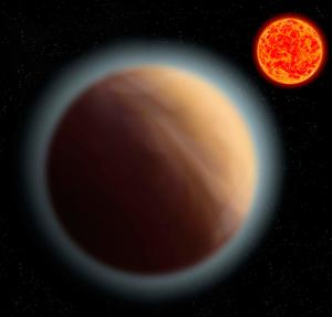 "Artist's impression issued by the Max Planck Institute for Astronomy (MPIA) of an Earth-sized planet orbiting a dim star 39 light years away which has a hazy atmosphere that could indicate the presence of a ""water world"", say scientists. PA"