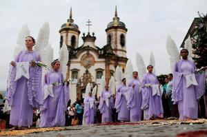 Participants dressed as angels march in the annual Easter procession during traditional Semana Santa (Holy Week) festivities on April 5, 2015 in Ouro Preto, Brazil. (Photo by Mario Tama/Getty Images)