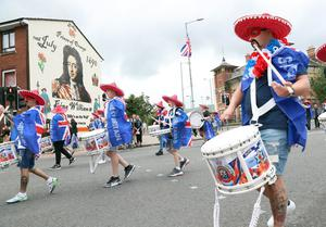 PACEMAKER, BELFAST, 13/7/2020: The First Ulster Flute Band parade past a mural that commemorates King William and the Battle of the Boyne in the Sandy Row area of Belfast today. The Orange Order did not take part in their traditional Twelfth of July processions this year because of the restrictions around Coronavirus but there were band parades around local areas across Northern Ireland. PICTURE BY STEPHEN DAVISON