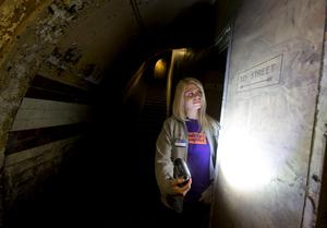 Lead guide Siddy Holloway in an underground tunnel at Down Street disused underground station in Mayfair, London, where Winston Churchill took refuge at the height of the Blitz, for the launch of a new season of Hidden London disused station tours. PRESS ASSOCIATION Photo. Picture date: Wednesday April 13, 2016. Down Street had a short life as a working station from 1907 to 1932, but became critical to winning the Second World War when it was covertly transformed into the Railway Executive Committee's bomb-proof bunker. Photo credit should read: Yui Mok/PA Wire