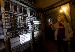 Lead guide Siddy Holloway next to the telephone exchange at Down Street disused underground station in Mayfair, London, where Winston Churchill took refuge at the height of the Blitz, for the launch of a new season of Hidden London disused station tours. PA