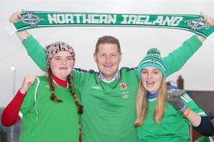 Northern Ireland fans (L-R) Charlotte Cummings with her father Paul and sister Zoe from Antrim. Picture by Jonathan Porter/PressEye