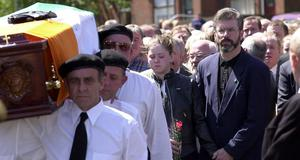 """PACEMAKER BFST 16-06-2000: Sinn Fein President Gerry Adams at the funeral of close friend and leading republican Terrance 'Cleeky"""" Clarke who died of cancer. Adams is pictured comforting Clarke's daughter Marie behind the cortege."""