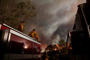 CLEARLAKE, CA - AUGUST 01:  Cal Fire firefighters monitor the progress of the Rocky Fire on August 1, 2015 near Clearlake, California. Over 1,900 firefighters are battling the Rocky Fire that burned over 22,000 acres since it started on Wednesday afternoon. The fire is currently five percent contained and has destroyed at least 14 homes.  (Photo by Justin Sullivan/Getty Images) *** BESTPIX ***