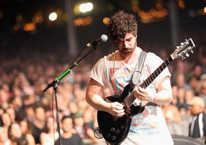 INDIO, CA - APRIL 12:  Musician Yannis Philippakis of Foals performs onstage during day 1 of the 2013 Coachella Valley Music & Arts Festival at the Empire Polo Club on April 12, 2013 in Indio, California.  (Photo by Karl Walter/Getty Images for Coachella)