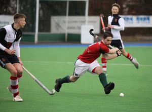 Friends School's Rory Brown, right, in action against Wallace High School during the Burney Cup Hockey Semi-Final.  Photo by Peter Morrison