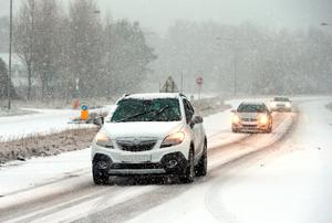 """Cars drive through snow on the A26 in Ballymena, Co Antrim, as blizzard conditions are set to sweep in, bringing """"a real taste of winter to the whole of the UK"""". Niall Carson/PA Wire"""