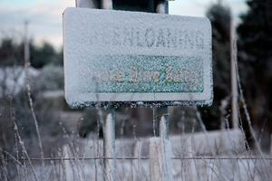 """Snow covers a road sign in Greenloaning, near Stirling, as blizzard conditions are set to bring """"a real taste of winter to the whole of the UK"""".  Andrew Milligan/PA Wire"""
