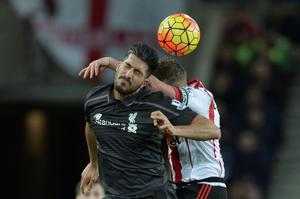 Liverpool's German midfielder Emre Can (L) beats Sunderland's English midfielder Lee Cattermole (R) to a header during the English Premier League football match between Sunderland and Liverpool at the Stadium of Light in Sunderland, north east England, on December 30, 2015. AFP PHOTO / OLI SCARFF  RESTRICTED TO EDITORIAL USE. No use with unauthorized audio, video, data, fixture lists, club/league logos or 'live' services. Online in-match use limited to 75 images, no video emulation. No use in betting, games or single club/league/player publications.OLI SCARFF/AFP/Getty Images