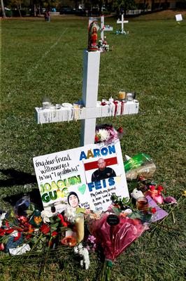 A memorial for student Joaquin Oliver and assistant football coach Aaron Feis, two of the victims of the Marjory Stoneman Douglas High School shooting, sits in a park in Parkland, Florida on February 16, 2018.   A former student, Nikolas Cruz, opened fire at the Florida high school leaving 17 people dead and 15 injured. / AFP PHOTO / RHONA WISERHONA WISE/AFP/Getty Images