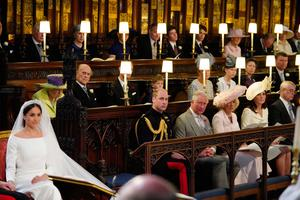 Meghan Markle in St George's Chapel, Windsor Castle for her wedding to Prince Harry watched by (middle row from left) Queen Elizabeth II, Duke of Edinburgh, Earl of Wessex, Viscount Severn, Countess of Wessex, Lady Louise Mountbatten-Windsor, Princess Royal, Sir Tim Laurence, (front row from left) Duke of Cambridge, Prince of Wales, Duchess of Cornwall Duchess of Cambridge, Duke of York.  . PRESS ASSOCIATION Photo. Picture date: Saturday May 19, 2018. See PA story ROYAL Wedding. Photo credit should read: Jonathan Brady/PA Wire
