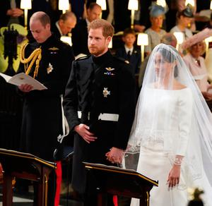 Britain's Prince Harry, Duke of Sussex (C) and US actress Meghan Markle (R) stand together at the altar in St George's Chapel, Windsor Castle, in Windsor, on May 19, 2018 during their wedding ceremony. / AFP PHOTO / POOL / Dominic LipinskiDOMINIC LIPINSKI/AFP/Getty Images