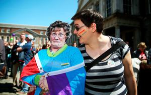 Bridget Hogg with a cardboard cutout of comedy creation Mrs Brown  at  the Central Count Centre in Dublin Castle, Dublin as votes are continued to be counted in the referendum on same-sex marriage.  PRESS ASSOCIATION Photo. Picture date: Saturday May 23, 2015. Ireland is set to enshrine the right to gay marriage in a historic world first. Key campaign groups fighting the rights reform conceded defeat, with results from around the country indicating a two to one majority of voters backing the constitutional change. See PA story IRISH GayMarriage. Photo credit should read: Brian Lawless/PA Wire
