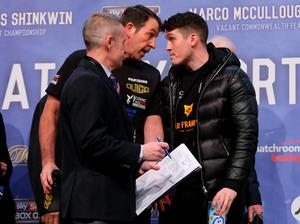 Face off: Trainers Joe Gallagher, left, and Shane McGuigan square up to each other in Manchester yesterday