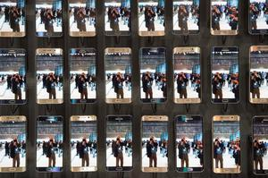 Visitors are reflected in numerous Samsung Galaxy S6 edge smartphones at the booth of South Korean electronics giant Samsung ahead of the opening of the 55th IFA (Internationale Funkausstellung) electronics trade fair in Berlin on September 3, 2015. IFA, Europe's largest consumer electronics and home appliances fair opens from September 4 to September 9, 2015.  AFP PHOTO / JOHN MACDOUGALLJOHN MACDOUGALL/AFP/Getty Images