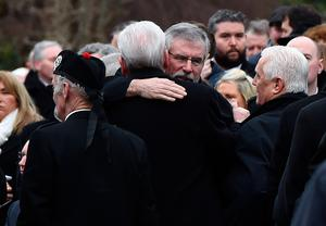 LONDONDERRY, NORTHERN IRELAND - MARCH 23:  Sinn Fein President Gerry Adams hugs a mourner outside Martin McGuinness' house on March 23, 2017 in Londonderry, Northern Ireland.  (Photo by Charles McQuillan/Getty Images)