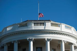 The US flag flies at half-staff at the White House in Washington, DC, September 11, 2015, to mark the 14th anniversary of the 9/11 attacks on the United States. AFP PHOTO / SAUL LOEBSAUL LOEB/AFP/Getty Images