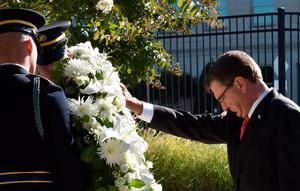 US Secretary of Defense Ash Carter places a wreath at the National 9/11 Pentagon Memorial on September 11, 2015, on the 14th anniversary of the 911 attacks.     AFP PHOTO/PAUL J. RICHARDSPAUL J. RICHARDS/AFP/Getty Images
