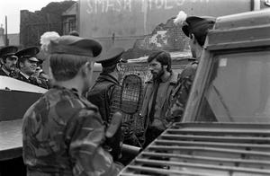 PACEMAKER PRESS INTL. BELFAST. Gerry Adams pictured in a confrontation with the police and the army on the Falls Rd after an arrest by the police. 13/2/84. 111/84/bw