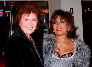 Shirley Bassey and Cilla Black arrive for the world premiere of Andrew Lloyd Webber's The Phantom Of The Opera at Odeon Leicester Square, central London in 2004. Andy Butterton/PA Wire.