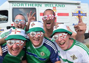Northern Ireland Fans Ian Thompson, George McFall , Russell Bridgett , Darren McDonald and Eddie McCullough   from Ballymena travel through St Georges de Reneines  in a camper van, on the way to Nice as N Ireland face Poland in their opening match on Sunday. Pic Colm Lenaghan/Pacemaker