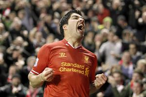 Liverpool's Luis Suarez celebrates scoring their fourth goal of the game during the Barclays Premier League match at Anfield, Liverpool
