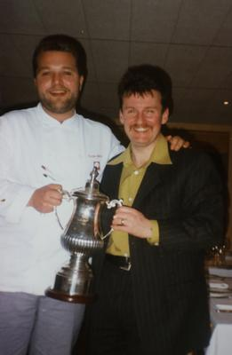 Former NI Chef of the year in 1997 Alex Taylor receiving his award form Robbie Millar.