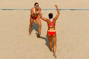 RIO DE JANEIRO, BRAZIL - AUGUST 09:  Kinga Kolosinska and Monika Brzostek of Poland celebrate their victory after the Women's Beach Volleyball Preliminary Pool A match against Ekaterina Birlova and Evgenia Ukolova of Russia on Day 4 of the Rio 2016 Olympic Games at the Beach Volleyball Arena on August 9, 2016 in Rio de Janeiro, Brazil.  (Photo by Ezra Shaw/Getty Images)