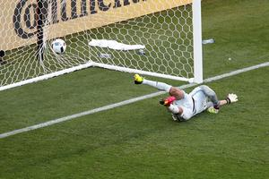 Portugal goalkeeper Rui Patricio fails to stop a shot from Hungary's Zoltan Gera opening the score during the Euro 2016 Group F soccer match between Hungary and Portugal at the Grand Stade in Decines-Charpieu, near Lyon, France, Wednesday, June 22, 2016. (AP Photo/Michael Sohn)