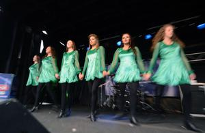 17/3/13 PACEMAKER PRESS INTL. Traditional Irish dancers perform to the huge crowd in Custom House Square as part of the annual St. Patrick's Day parade festival in Belfast. Picture Charles McQuillan/Pacemaker.