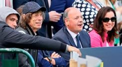 Mick Jagger enjoys a Guinness as he watches play on day three of Ireland's inaugural test match against Pakistan at Malahide cricket club. AFP PHOTO / Paul FAITHPAUL FAITH/AFP/Getty Images