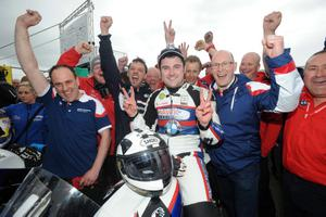 PACEMAKER BELFAST  17/05/2014 Michael Dunlop (8) celebrates victory in the North West 200 feature race during todays Vauxhall International North West 200. Photo Stephen Davison/Pacemaker Press