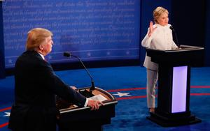 Democratic nominee Hillary Clinton (R) speaks as Republican nominee Donald Trump looks on during the final presidential debate at the Thomas & Mack Center on the campus of the University of Las Vegas in Las Vegas, Nevada on October 19, 2016. AFP/Getty Images