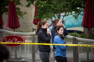 People gather at the scene of a balcony collapse in Berkeley (AP Photo/Noah Berger)